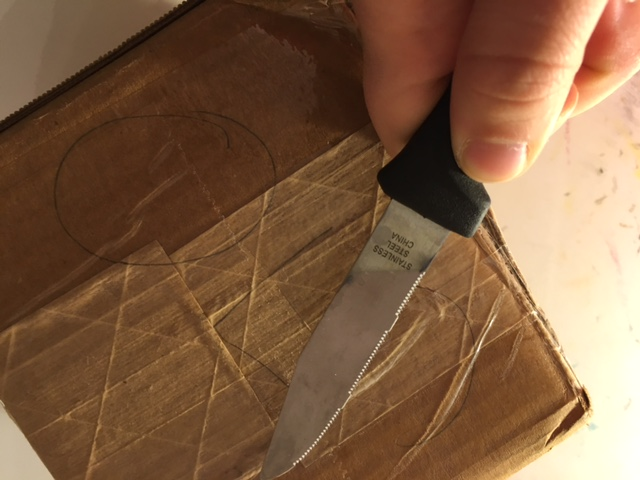 It's taped shut very securely, but nothing a sharp knife can't handle!